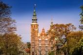 scenic view of beautiful historical palace between trees in copenhagen, denmark