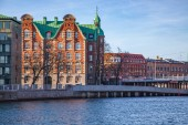 cityscape with buildings and river in Copenhagen, Denmark