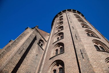 low angle view of majestic historical castle against blue sky, copenhagen, denmark