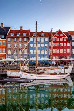 COPENHAGEN, DENMARK - MAY 6, 2018: boats and beautiful historical buildings reflected in calm water, copenhagen, denmark stock vector