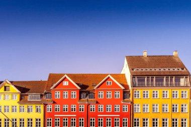 Beautiful colorful historical houses against blue sky in copenhagen, denmark stock vector