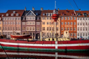 COPENHAGEN, DENMARK - MAY 6, 2018: boat moored near beautiful historical buildings in copenhagen, denmark