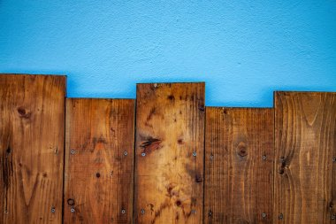 top view of brown wooden planks and blue background
