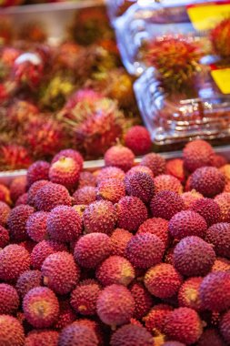 close up image of pile of lychees on market place