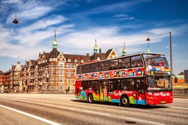 COPENHAGEN, DENMARK - MAY 6, 2018: Sightseeing bus with tourists on street in Copenhagen, Denmark