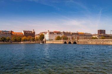 COPENHAGEN, DENMARK - MAY 6, 2018: cityscape with river and bridge