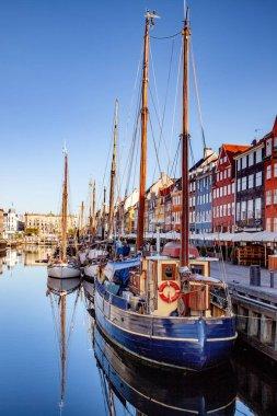 COPENHAGEN, DENMARK - MAY 6, 2018: moored boats at harbor near buildings in Copenhagen, Denmark