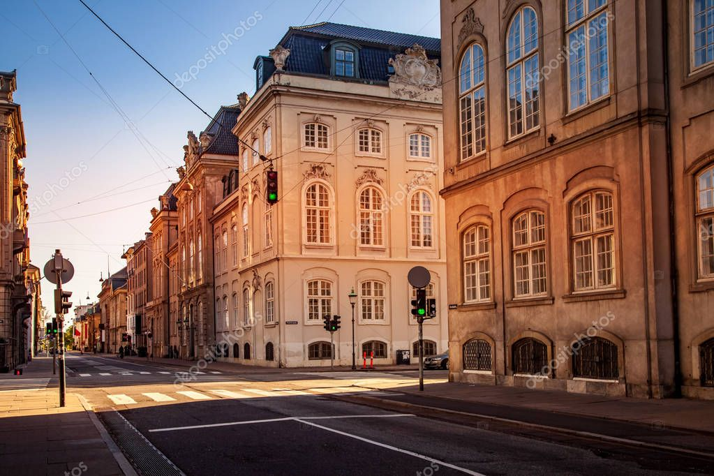 COPENHAGEN, DENMARK - MAY 6, 2018: scenic view of cityscape with buildings and empty street
