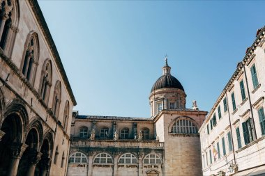 low angle view of Virgin Mary Ascension Cathedral and clear blue sky in Dubrovnik city, Croatia