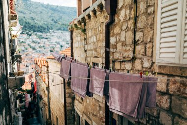 urban scene with laundry and empty narrow city street in Dubrovnik, Croatia