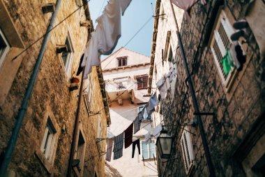 urban scene with laundry and empty narrow city street in Dubrovnik, Croatia
