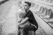 Fotografie black and white photo of mother and son hugging on stadium