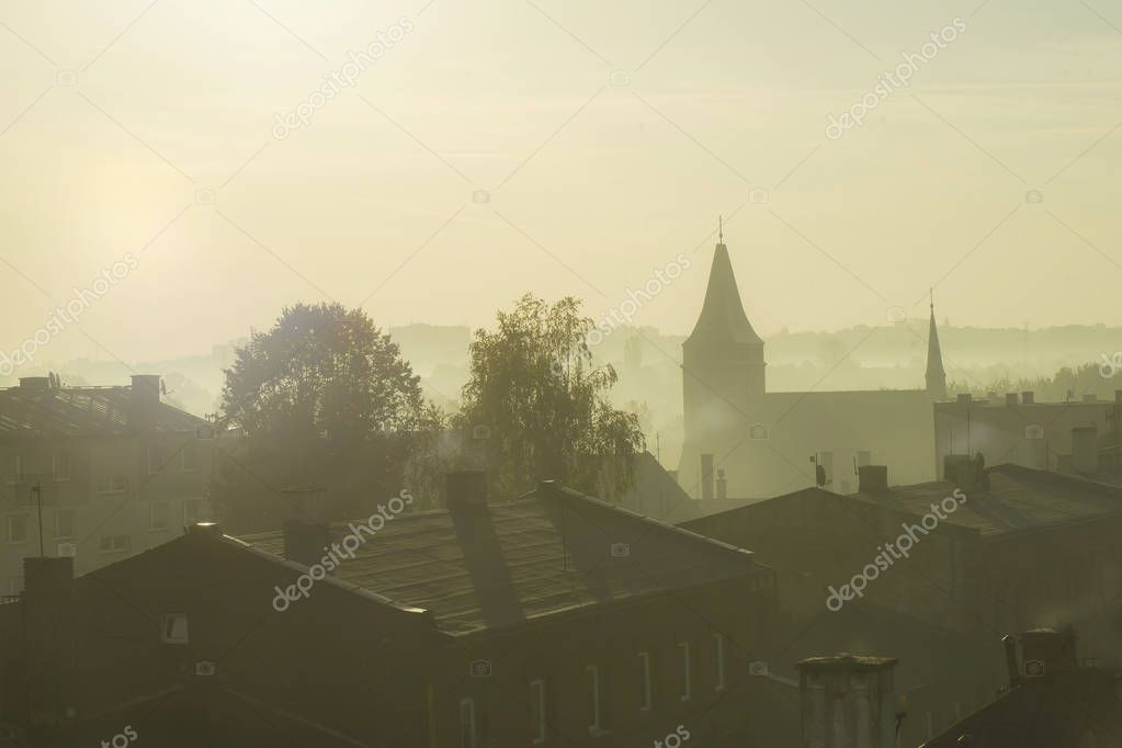 Ecology and pollution concept - A city in the morning with smoking chimneys