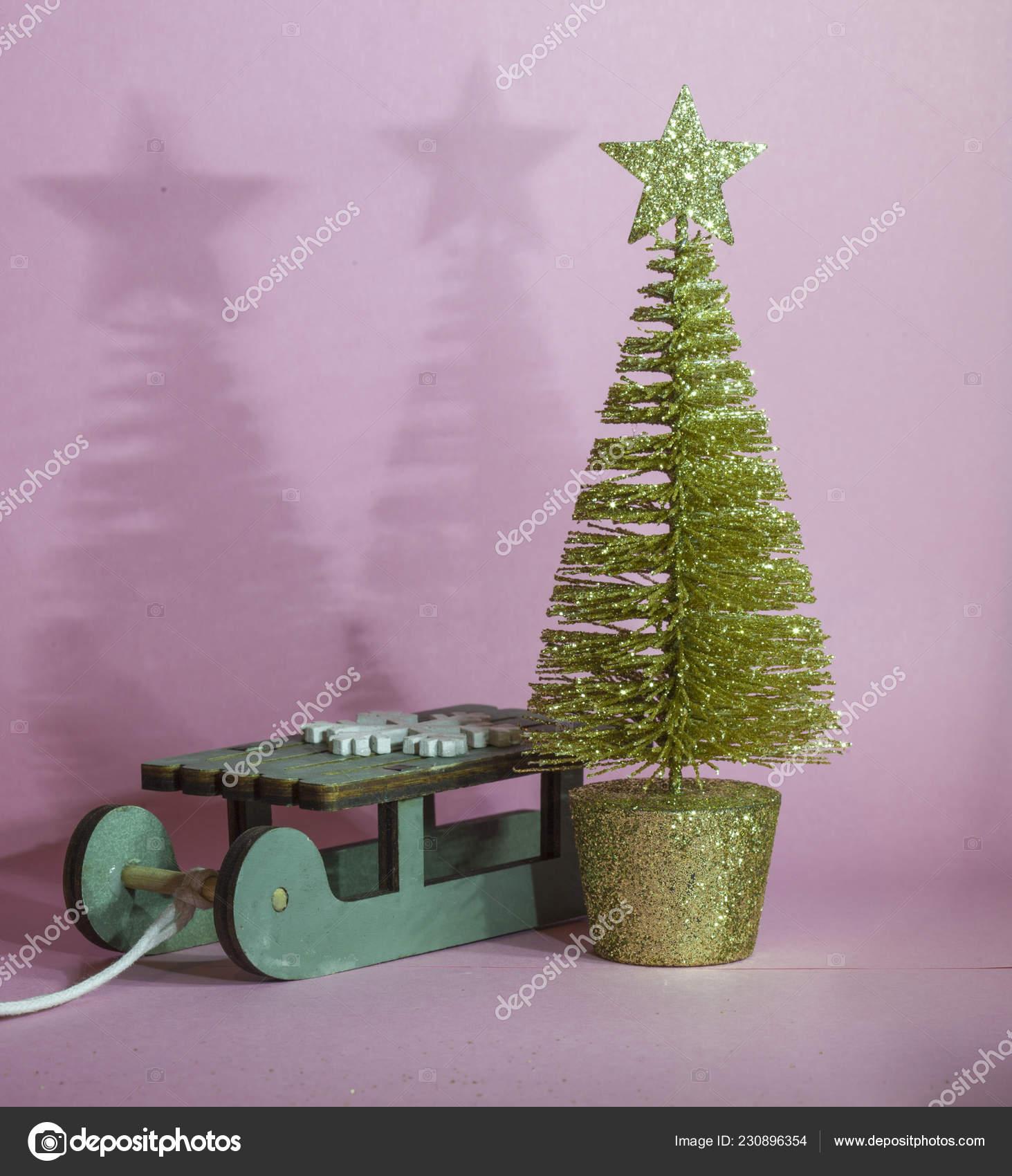 Golden Christmas Tree Wooden Sled Pink Background Festive