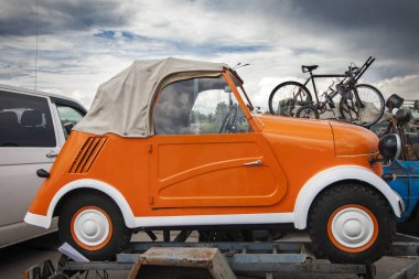 KIEV, UKRAINE - MAY 10, 2019: a small orange double car at an exhibition of retro cars