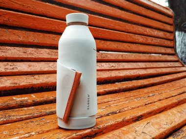 KIEV, UKRAINE - OCTOBER 13, 2019: smart reusable bottle for water. With silicone strap. Ideal for an active lifestyle and avoiding the use of plastic bottles
