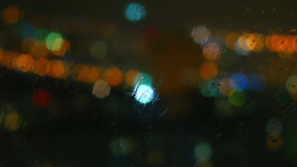 Rainy Days Rain Drops On Window Surface And Colorful Traffic Bokeh Light
