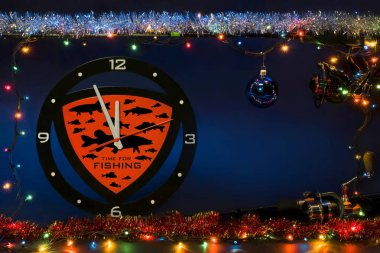 New year fishing concept. Clock with fish silhouettes and holiday garland with tackles