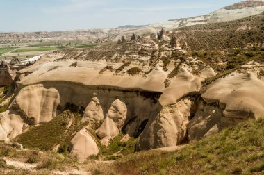 scenic view of grass on slopes in valley, Cappadocia, Turkey