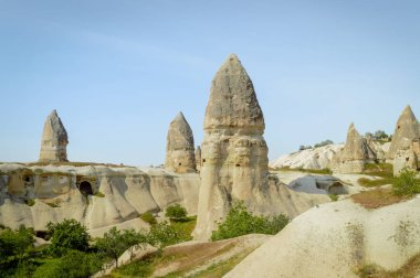 front view of old cave dwelling and fairy chimneys in valley of Cappadocia, Turkey