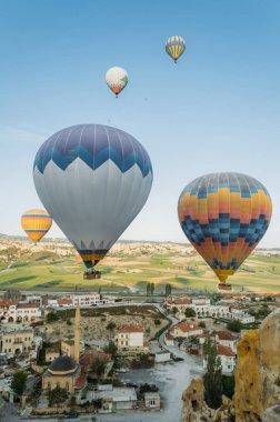 Closeup view of colorful hot air balloons over city in Cappadocia, Turkey stock vector