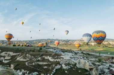 Front view of hot air balloons flying over cityscape, Cappadocia, Turkey stock vector