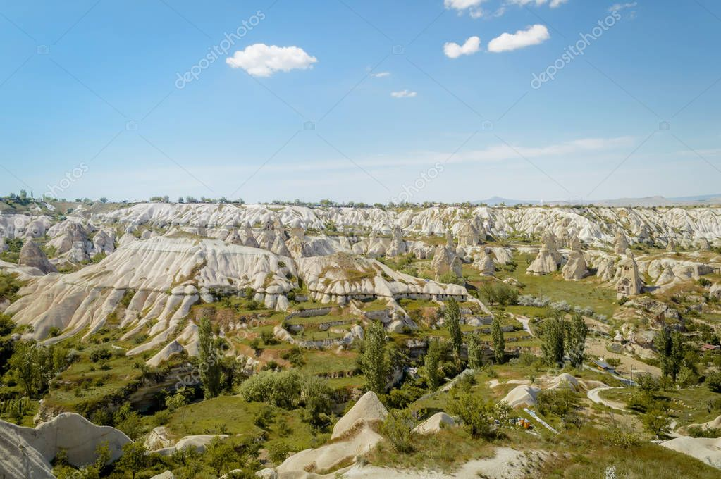 scenic view of green rocky highland under blue sky in Cappadocia, Turkey