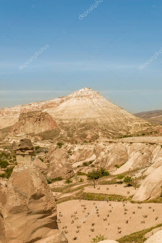 front view of mountains in valley under blue sky, Cappadocia, Turkey
