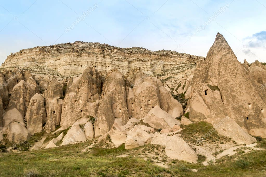front view of rocky hills and mountain under blue sky, Cappadocia, Turkey