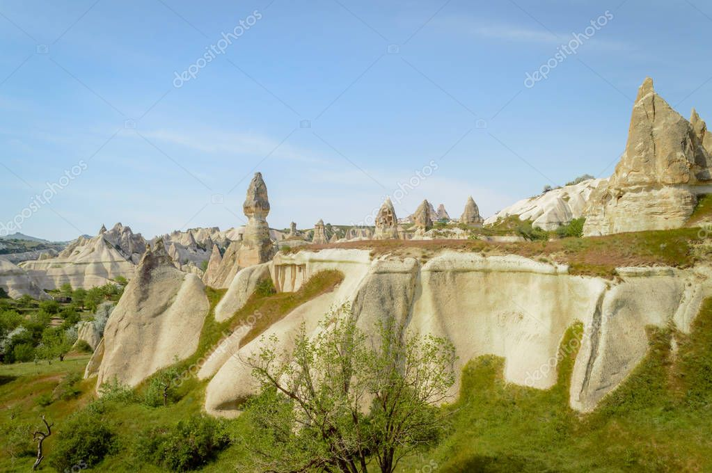 scenic view of stone formations on slopes in valley of Cappadocia, Turkey