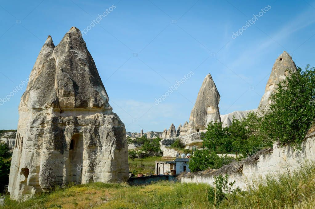 old dwellings in stone formations in valley of Cappadocia, Turkey