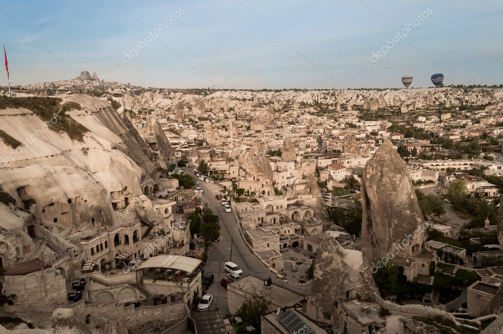 aerial view of cars and buildings from stone formations in Cappadocia, Turkey