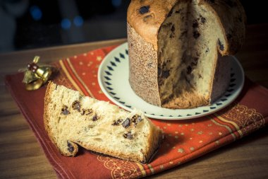 Panettone. Traditional italian dessert for christmas with chistimas light on background