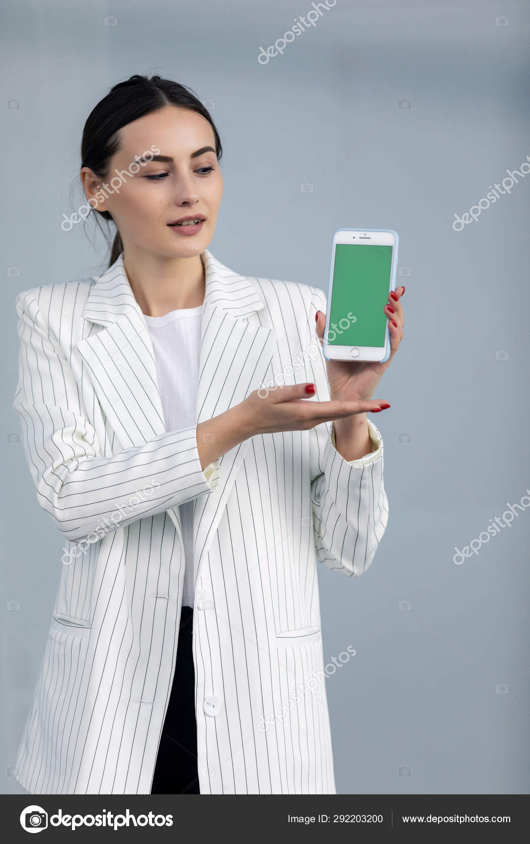 Smiling Young Business Woman White Jacket Showing Smartphone