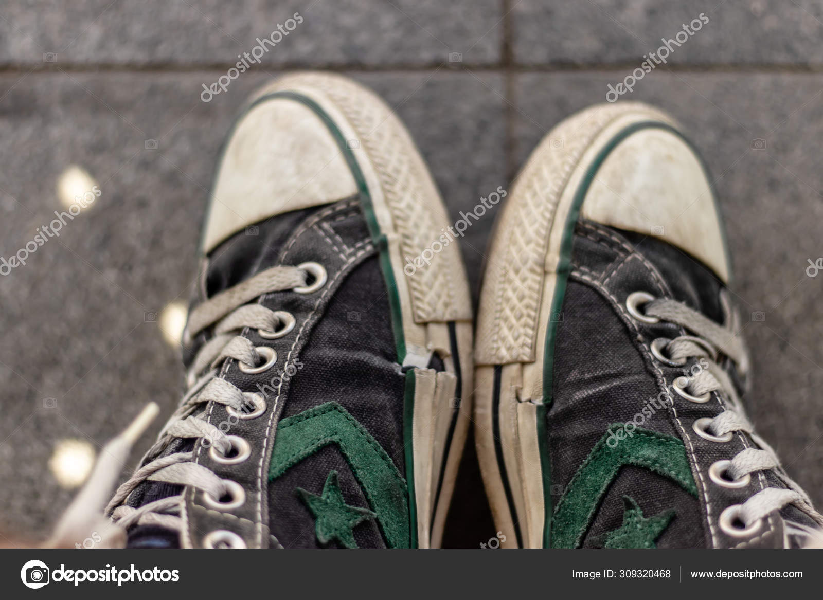 Old converse all-star shoes with green star and wales on it Stock ...