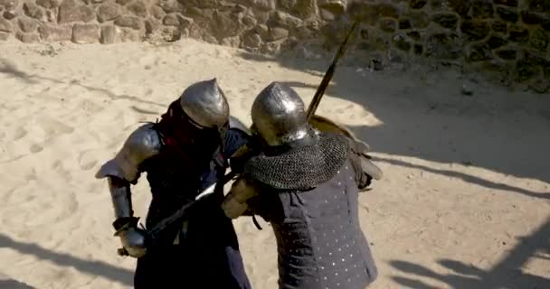 medieval duel fight in armor on swords