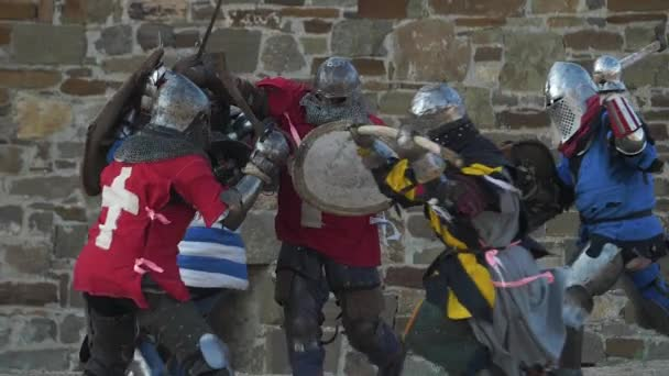 Fierce battle of knights against the castle walls Strikes with swords shields and axes