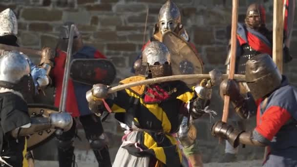 Group battle of soldiers in armor on the field Teamwork Slow motion