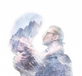 Double exposure portrait of hugging couple with mountains. Romance and people concept