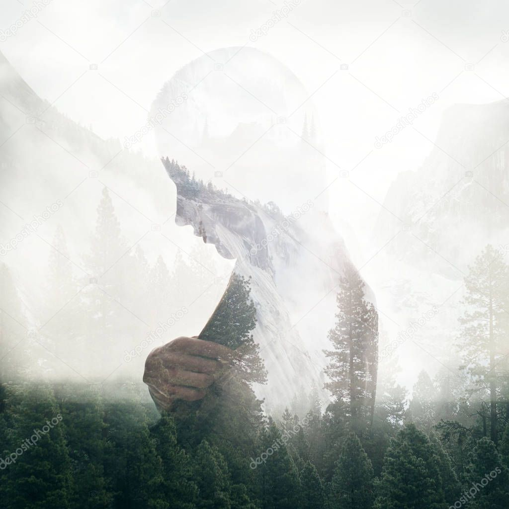 Double exposure portrait of woman and green forest trees in mountains