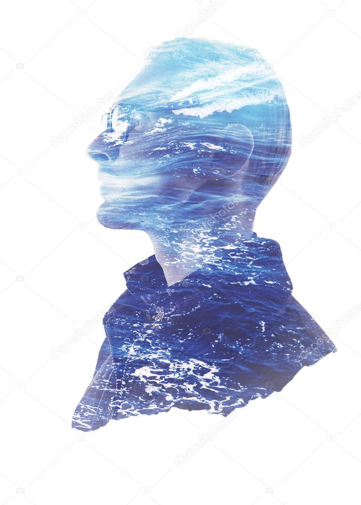 Double exposure silhouette portrait of thoughtful man with blue ocean waves