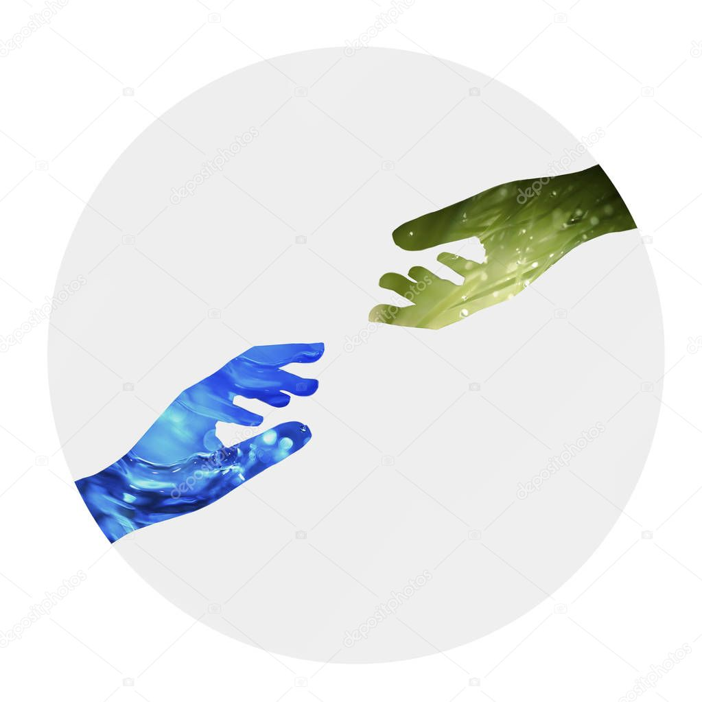 Nature basic elements on silhouettes of hands. Unity of Water and Earth in circle on gray background