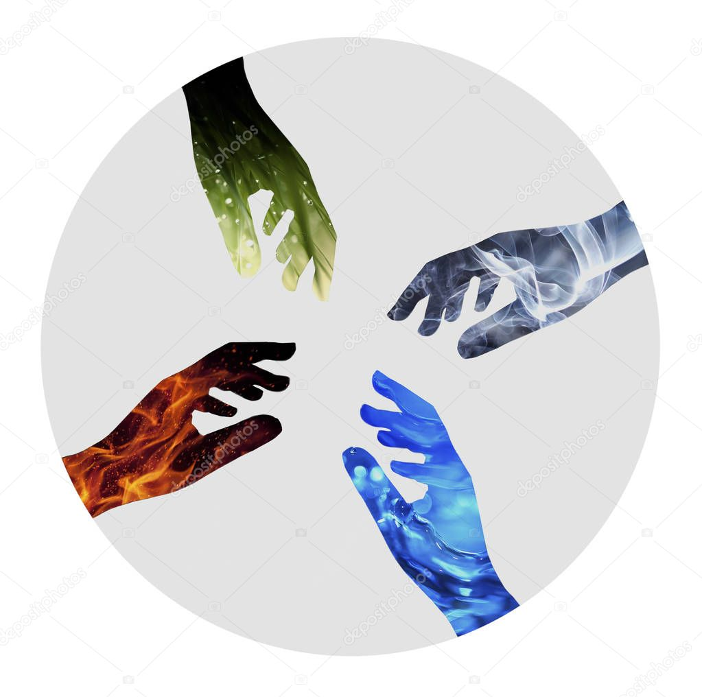 Nature four elements unity. Water, Fire, Earth, Air on silhouette of hands