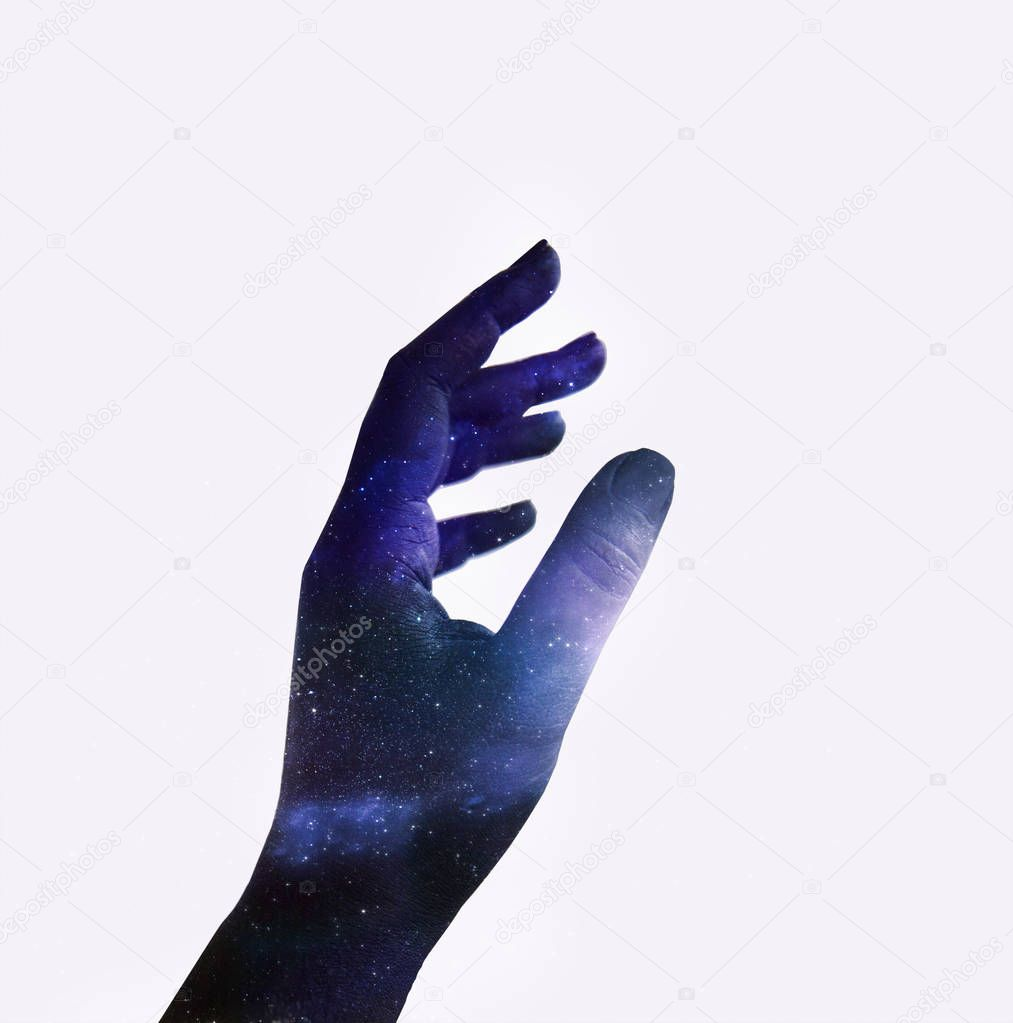 Double exposure of hand with texture of colorful space sky with stars