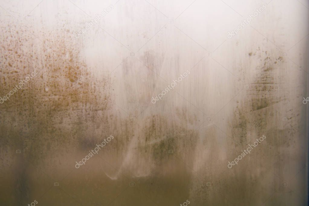 Vintage tone image of rain drops on foggy glass. Blurred grunge texture with gradient