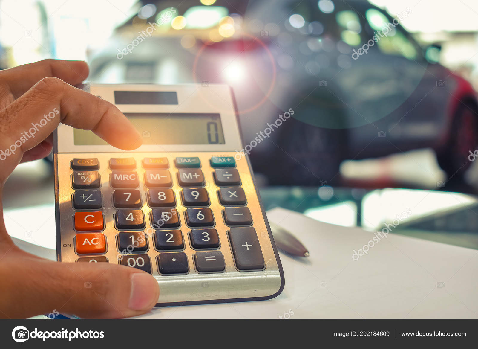 Asian Man Pressing Calculator Business Finance Car Showroom Blurry