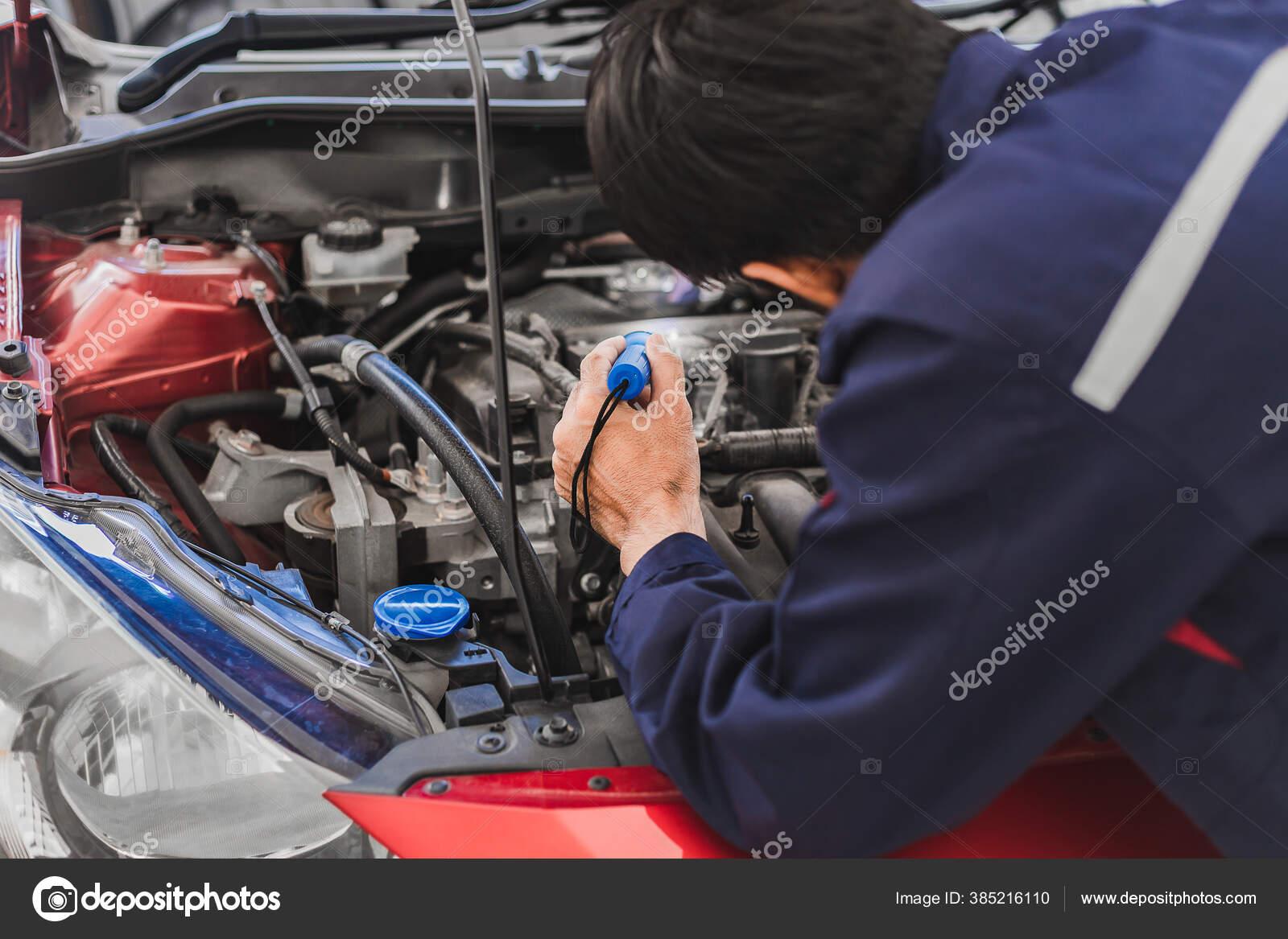 Asian Man Mechanic Inspection Shine Torch Car Engine Checking Bug Stock Photo C Oatstocker 385216110