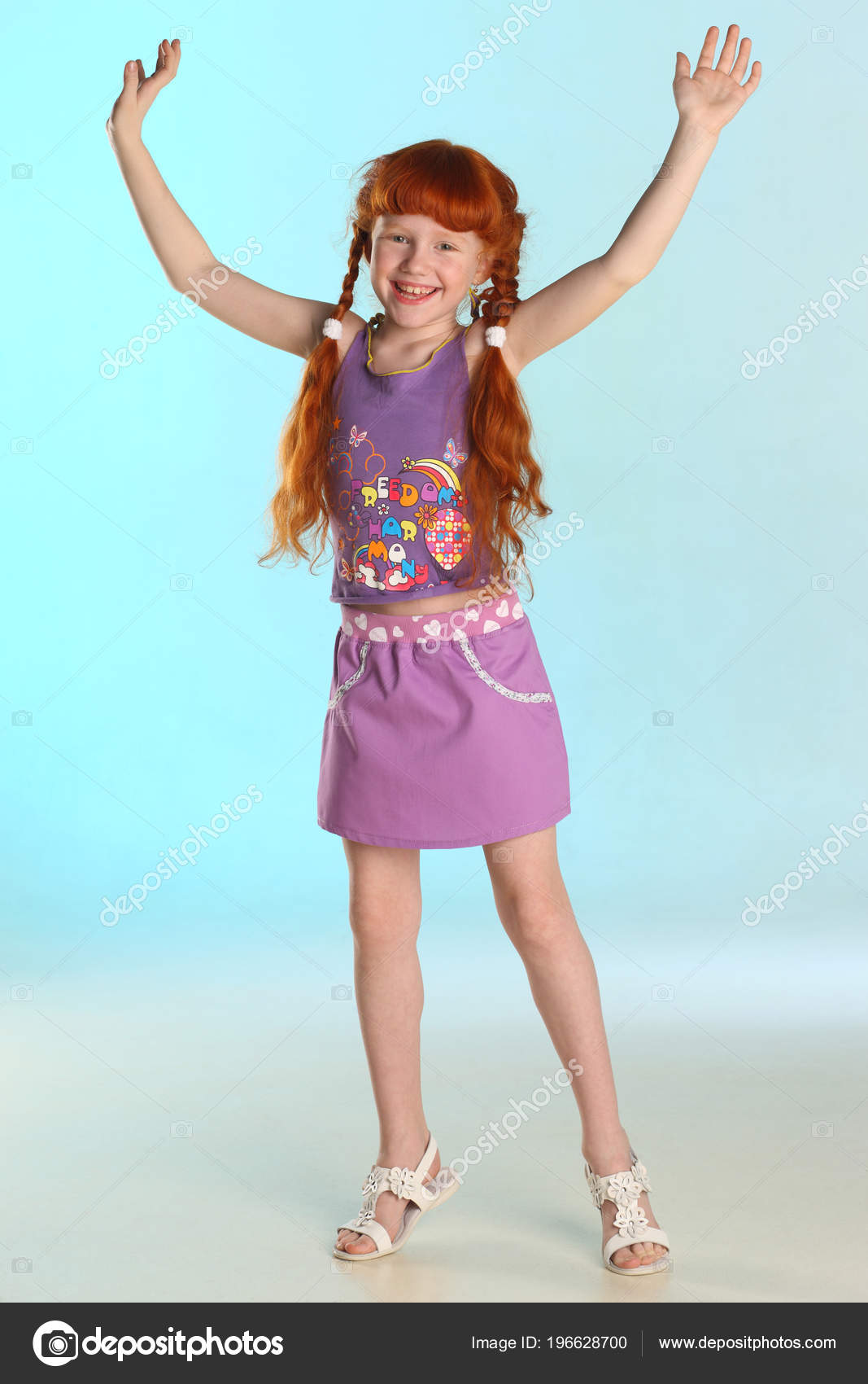 Beautiful Charming Little Redhead Girl Shows Her Summer