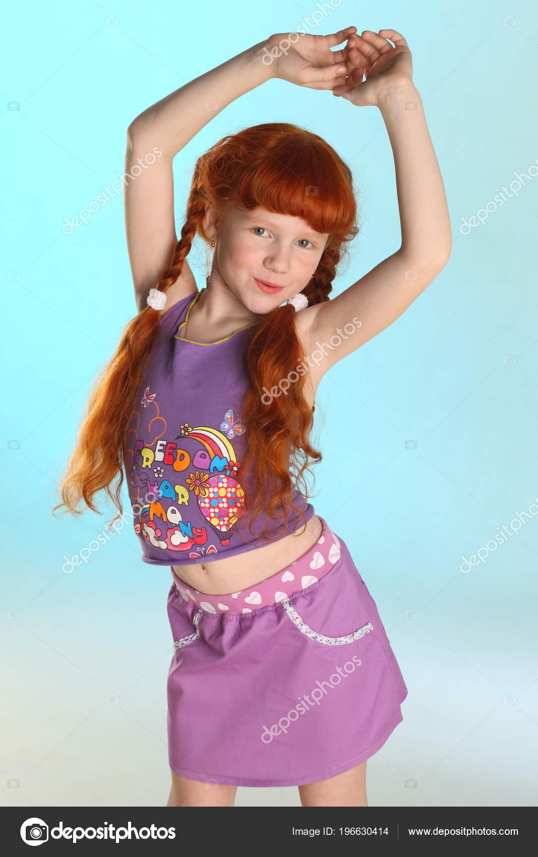 Tiny nude redhead
