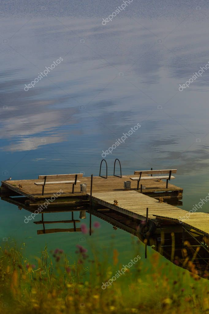 The cozy wooden pier on the lake. Bank of the Seliger
